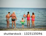 family are resting on the... | Shutterstock . vector #1325135096