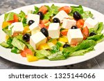 geek salad on table with freesh ... | Shutterstock . vector #1325144066