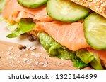 salmon sandwich with fresh... | Shutterstock . vector #1325144699