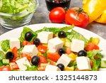 greek salad with ingredients on ... | Shutterstock . vector #1325144873