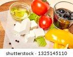 ingredients for greek salad on... | Shutterstock . vector #1325145110