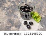 black olives in glass on... | Shutterstock . vector #1325145320