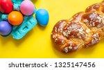 easter eggs and tsoureki braid  ... | Shutterstock . vector #1325147456