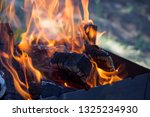 firewood coals in ashes in fire ... | Shutterstock . vector #1325234930