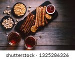beer and appetizing snacks....   Shutterstock . vector #1325286326