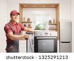 repairman working with a drill... | Shutterstock . vector #1325291213