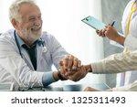 senior male doctor talking to...   Shutterstock . vector #1325311493