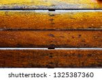 droplet of water on wood and... | Shutterstock . vector #1325387360