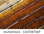 droplet of water on wood and... | Shutterstock . vector #1325387369