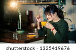 a beautiful asian woman is in a ... | Shutterstock . vector #1325419676