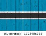 botswana flag painted on old...   Shutterstock . vector #1325456393
