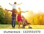 happy active family... | Shutterstock . vector #1325531570