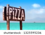 A Wooden Sign Of Pizza  Sea...
