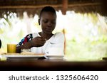 young african girl in resort... | Shutterstock . vector #1325606420