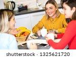 three girls enjoy talking while ... | Shutterstock . vector #1325621720