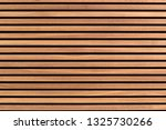 Small photo of Wooden slats. Natural wood lath line arrange pattern texture background