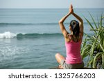 woman practice yoga at seaside... | Shutterstock . vector #1325766203