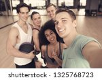 group of sportive people taking ... | Shutterstock . vector #1325768723