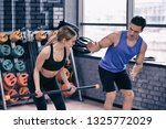 young woman training with coach ... | Shutterstock . vector #1325772029