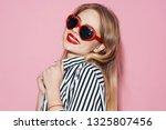 cheerful glamorous woman in... | Shutterstock . vector #1325807456