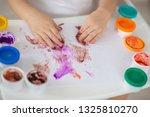 the child draws finger paints... | Shutterstock . vector #1325810270
