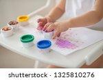 the child draws finger paints... | Shutterstock . vector #1325810276
