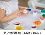 the child draws finger paints... | Shutterstock . vector #1325810336