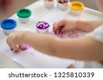 the child draws finger paints... | Shutterstock . vector #1325810339