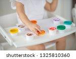 the child draws finger paints... | Shutterstock . vector #1325810360