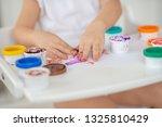 the child draws finger paints... | Shutterstock . vector #1325810429