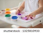 the child draws finger paints... | Shutterstock . vector #1325810933
