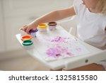the child draws finger paints... | Shutterstock . vector #1325815580
