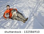 young man playing with husky... | Shutterstock . vector #132586910