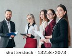 successful business coach.... | Shutterstock . vector #1325872073