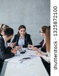 business team meeting.... | Shutterstock . vector #1325872100