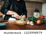 female chef chopping raw... | Shutterstock . vector #1325998979
