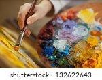 artist paints a picture of oil... | Shutterstock . vector #132622643