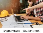 group of two coworkers working... | Shutterstock . vector #1326343286