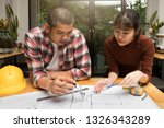 group of two coworkers working... | Shutterstock . vector #1326343289