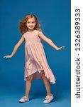 fashionable little girl in a... | Shutterstock . vector #1326389333
