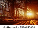 Small photo of Construction Scaffoldings abstract scaffold with sunset in the background