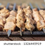 shish kebab on skewers is fried ... | Shutterstock . vector #1326445919