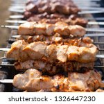 shish kebab on skewers is fried ... | Shutterstock . vector #1326447230
