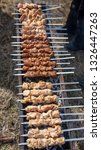 shish kebab on skewers is fried ... | Shutterstock . vector #1326447263