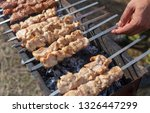 shish kebab on skewers is fried ... | Shutterstock . vector #1326447299