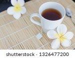 cup of dark tea on bamboo... | Shutterstock . vector #1326477200