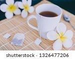 cup of dark tea on bamboo... | Shutterstock . vector #1326477206