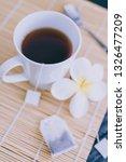 cup of dark tea on bamboo... | Shutterstock . vector #1326477209