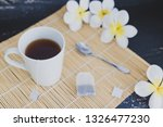 cup of dark tea on bamboo... | Shutterstock . vector #1326477230