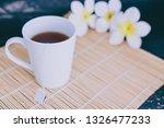 cup of dark tea on bamboo... | Shutterstock . vector #1326477233